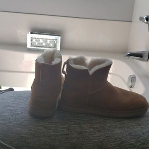 Tan UGG  ankle boots.